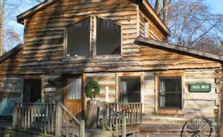 The Redbud Cabin is one of the many Hocking Hills cabins offered by the Inn & Spa at Cedar Falls. It's ideal for 2 to 4 people, wheelchair accessible, and has two bedrooms, each with a king-size bed and bathroom.