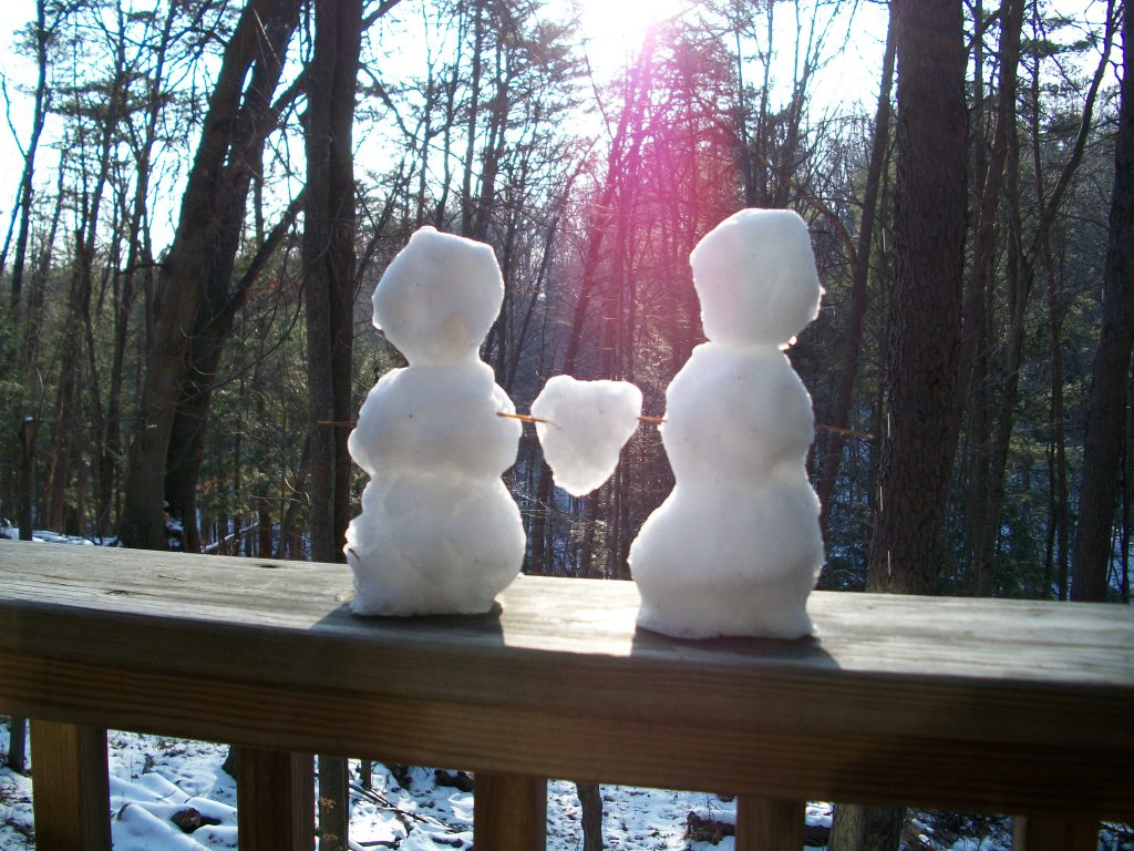 """snow couple on Valentine weekend"""