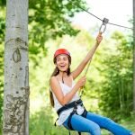 Girl on a zipline enjoying Hocking Hills Canopy Tours