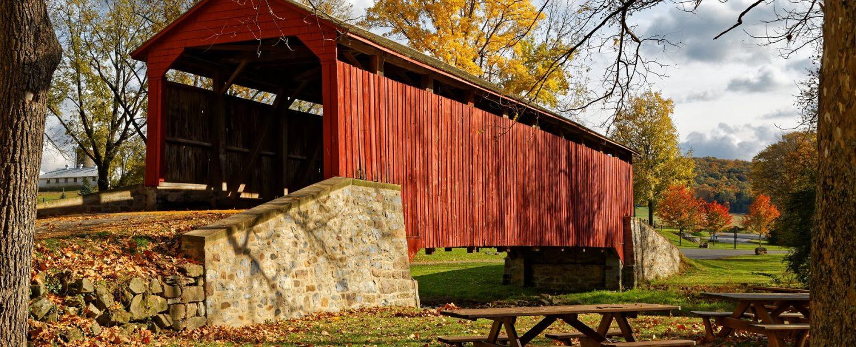 red covered bridge in autumn