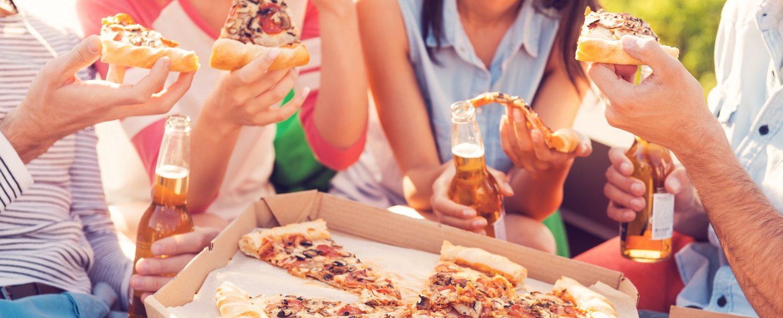 people enjoying pizza outside in Logan, Ohio