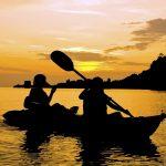 Two people enjoying hocking hills canoeing at sunset