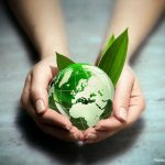 Hands holding the earth representing a green certified business