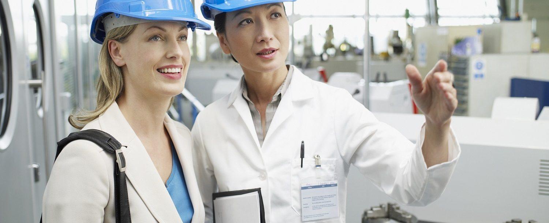 Businesswomen in hard-hats talking