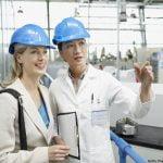 Two women in hard hats enjoying Ohio factory tours