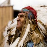 American Indian tribal chief in traditional headress at the Tecumseh outdoor drama
