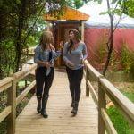 2 women walking on deck
