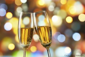 Champagne Toast with blurred lights in background
