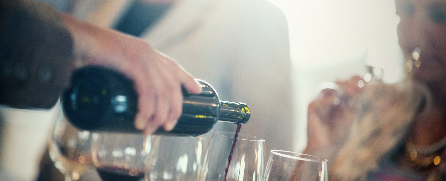 bartender pouring various wines for wine tasting