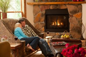 couple by the fireside lounge