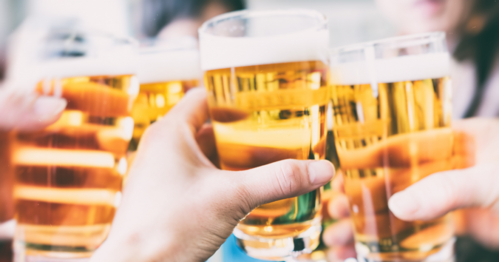 People toasting glasses with beer.