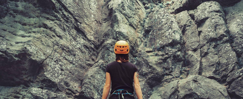 Woman getting ready to rock climb