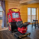 motorcylce arcade game in basement of lodge