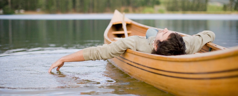 Man floating in a canoe.