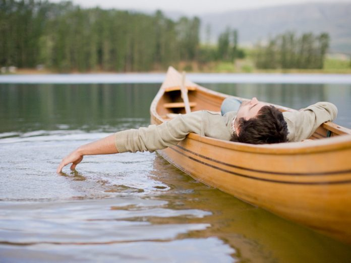 Man floating in a canoe.