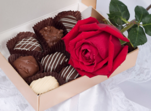 Chocolates and a rose.