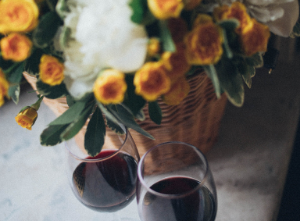 Flower basket and two glasses of red wine.