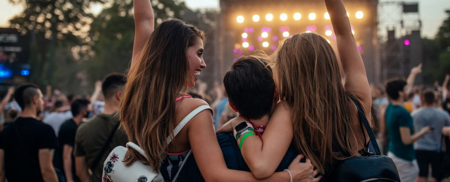 Group of people at an outdoor music festival.