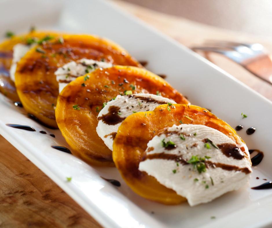 Peaches and mozzarella with balsamic glaze.