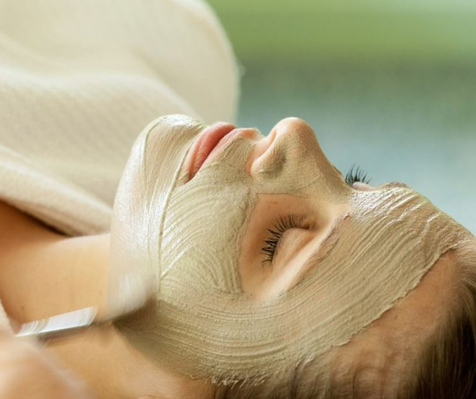 Woman getting a facial at the spa.