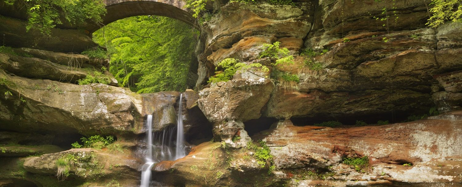 The Upper Falls waterfall and bridge in Hocking Hills State Park, Ohio, USA.